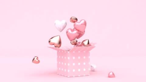 vidéos et rushes de ouvrir le coffret nombreux coeur forme goutte 3d rendu numérique motion - cadeau