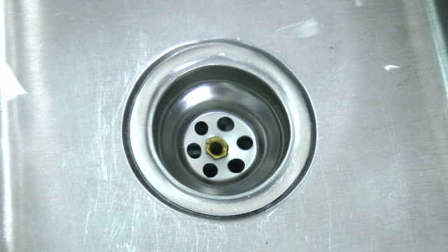 Open kitchen sink sewer. Right hand opening sink sewer plung and running water video
