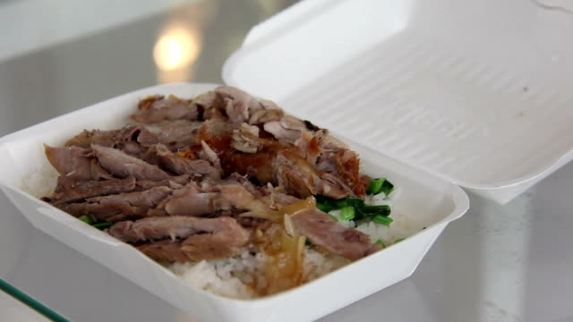 open launch box of stewed pork leg on rice video