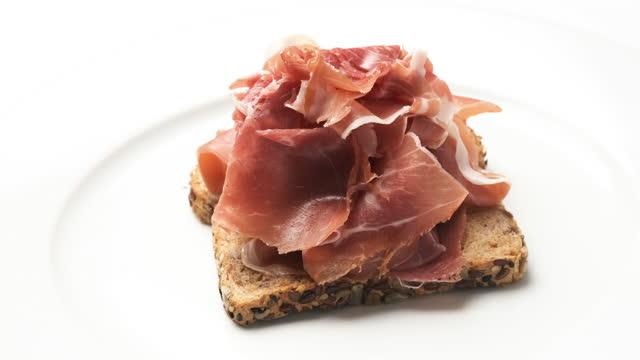 Open sandwich of cured prosciutto