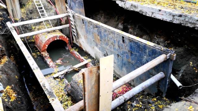 Open sewer during street repairs handheld 4k video