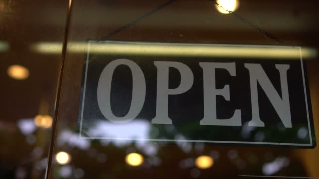 open sign at the store door - open sign stock videos & royalty-free footage