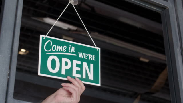 open sign on the shop's window - open sign stock videos & royalty-free footage