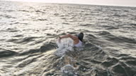 istock SLO MO Open water swimmer swimming in the choppy sea 1031190518