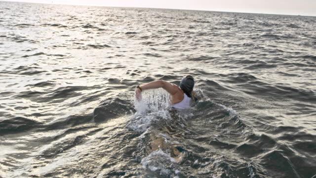 SLO MO Open water swimmer swimming in the choppy sea