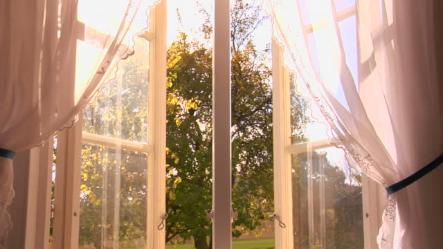 Open window with white curtains video