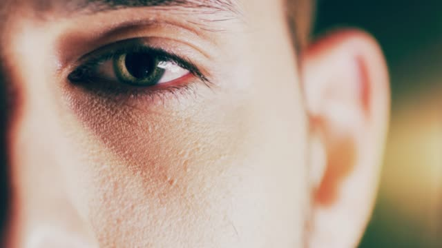 Open your eyes to what's in front of you Closeup 4K video footage of a man opening his eyes against a dark background eyesight stock videos & royalty-free footage