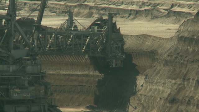 Open-cast mining. Giant bucket-wheel excavator. Wheel moves to the right. Medium shot. Surface mine. video