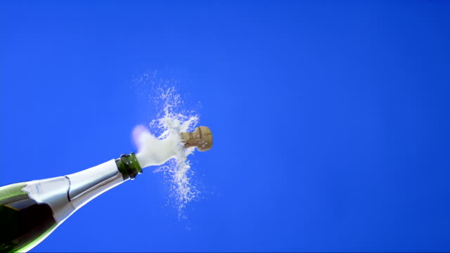 Opening A Bottle Of Champagne (Super Slow Motion) HD1080p: Super Slow Motion shot of a cork popping out of a champagne bottle,  isolated on a blue background. bottle stock videos & royalty-free footage