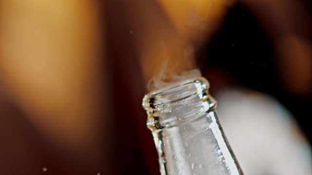 SLO MO Opening a bottle of soft drink