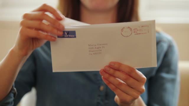 Opening a letter          LI CM RO