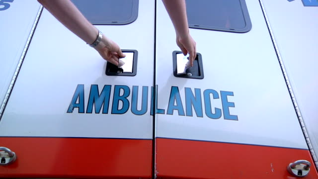 Opening Ambulance Doors Opening ambulance doors. stretcher stock videos & royalty-free footage