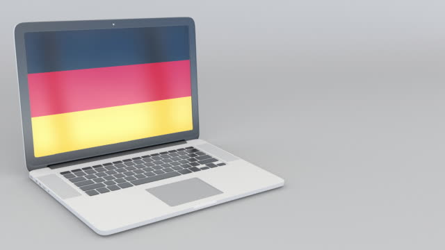 Opening and closing laptop with flag of Germany on the screen