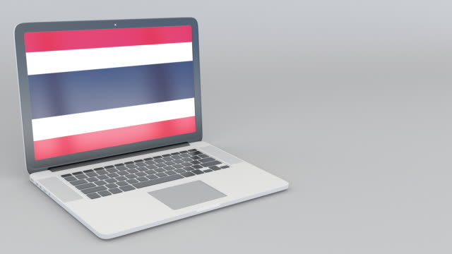 Opening and closing laptop with flag of Thailand on the screen