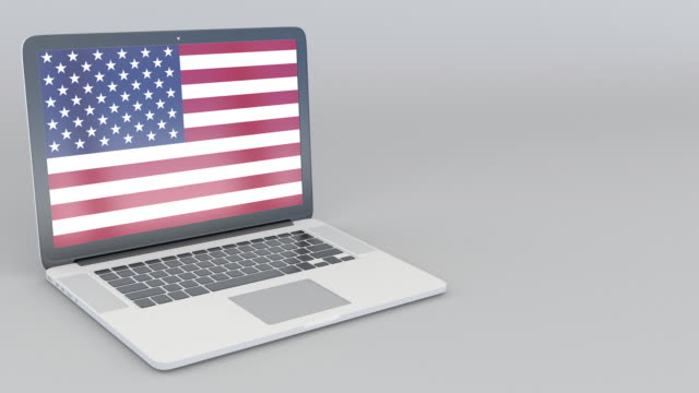 Opening and closing laptop with flag of the United States on the screen