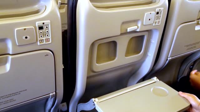 opening and closure individual cabin seat table, stock video - taca filmów i materiałów b-roll