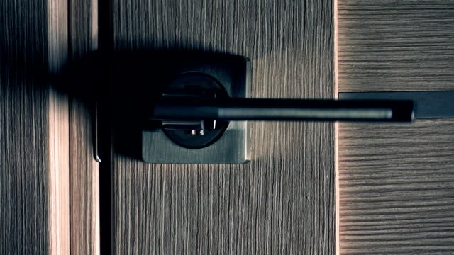 Opening modern interior door, dark background. Unknown and obscurity concept, FullHD racking focus close up shot video