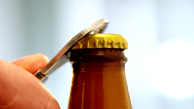 Opening of beer cap Close up man's hand opening beer. Video. bottle stock videos & royalty-free footage