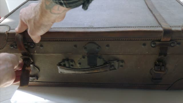 Opening old suitcase video