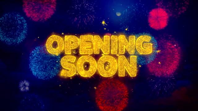 vídeos y material grabado en eventos de stock de apertura pronto saludo texto chispa partículas en fuegos artificiales de colores - inauguration