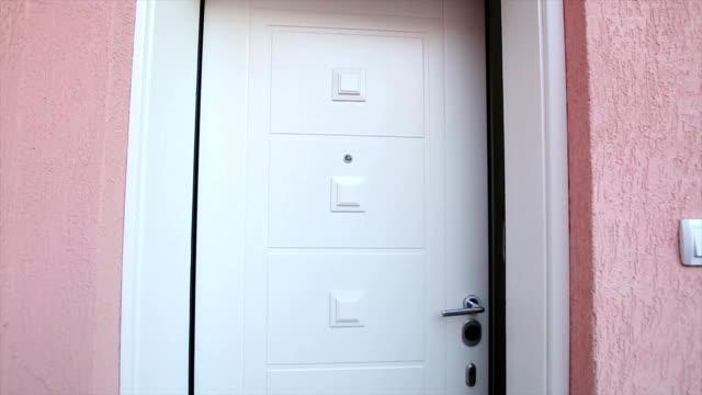 Opening the door Opening the Front Modern Door front door stock videos & royalty-free footage