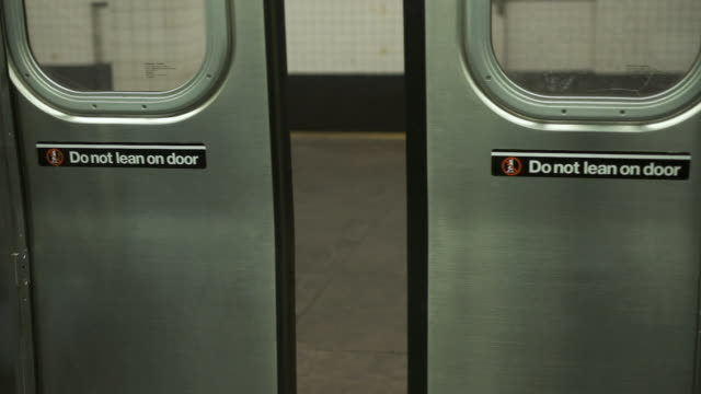 Opening The Doors Of The Train. Subway Of New York. Close-up. Train Opens The Door. Do Not Lean On Door. Subway Station In New York. Close-up. underground stock videos & royalty-free footage