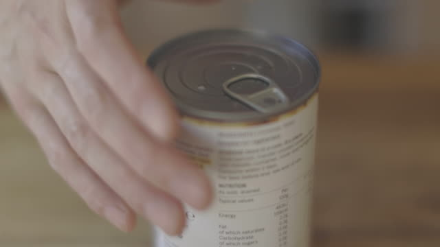 opening tin of chickpea close up view of opening tin of chickpea jar stock videos & royalty-free footage