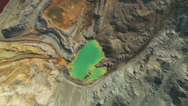 Open-pit mine Aerial zoom out of a lake filled with turquoise colored water in open-pit mine in Majdanpek, Serbia. mining natural resources stock videos & royalty-free footage