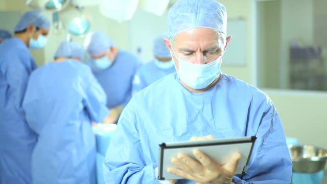 Operating Room Portrait Surgeon Wireless Tablet Foreground video