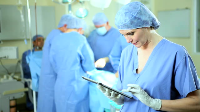 Operating Room Portrait Theatre Nurse Wireless Tablet Foreground video
