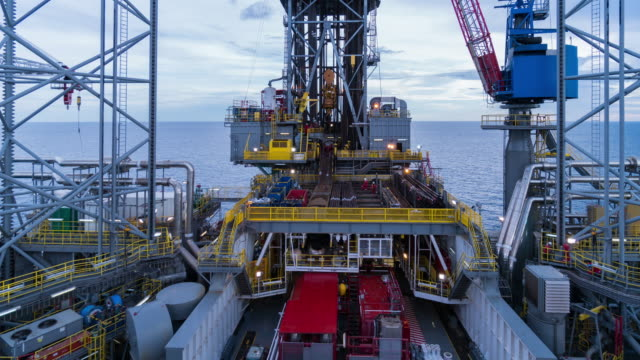 operation in offshore oil drilling rig time lapse day time - opec video stock e b–roll