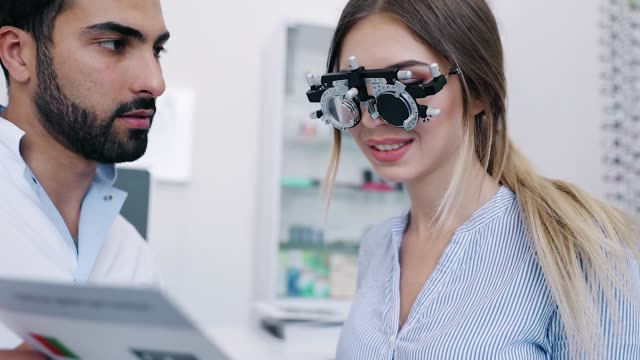 Ophthalmology Clinic. Eye Doctor Testing Woman Eyesight video