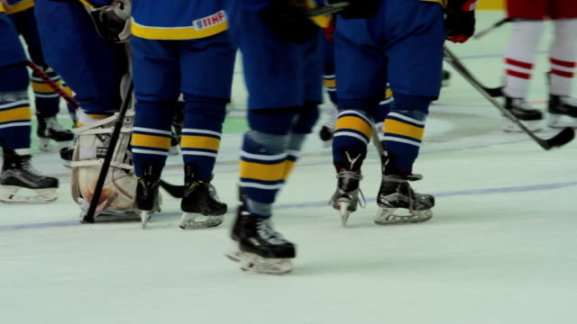opposing hockey teams playing match, players body checking rivals on ice rink - hockey stock videos and b-roll footage
