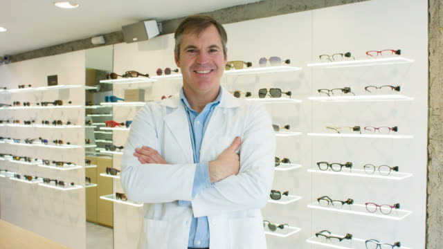 Optician selling glasses at the optics video