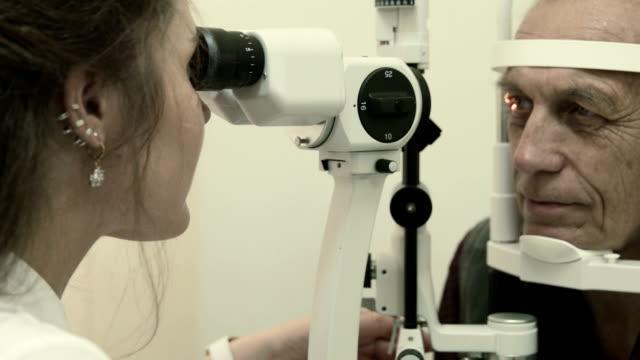 Optometrist examines man's eyesight video