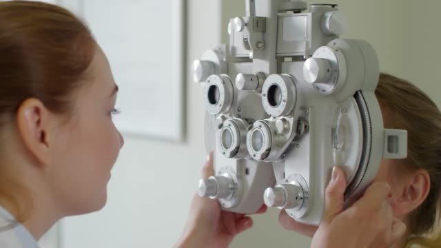 Optometrist Using Phoropter to Check Eyesight of Patient video
