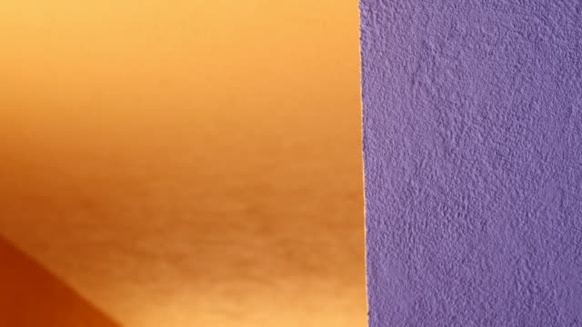 orange and purple background contrast design wall