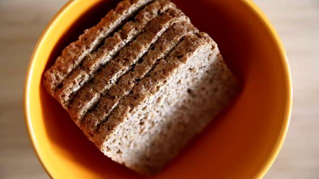 Orange bowl with bread video