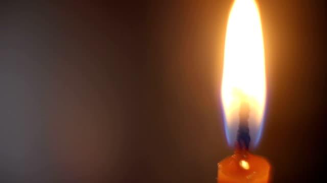 Orange burning candle close-up video