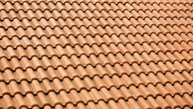 orange clay tiles on the roofs of houses orange clay tiles on the roofs of houses in Montenegro tile stock videos & royalty-free footage