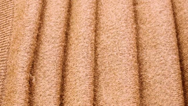 orange drapery satin fabric. crumpled fabric with smooth bends. close up - гладкая поверхность стоковые видео и кадры b-roll