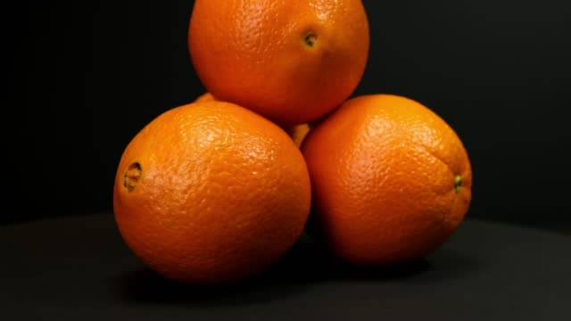orange fruit rotating on a black background. - icon set healthy video stock e b–roll