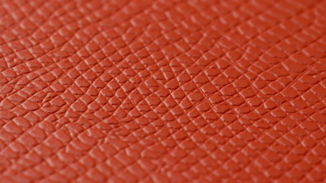 stockvideo's en b-roll-footage met oranje lederen textuur oppervlak achtergrond macro close-up. - dierenhuid huid