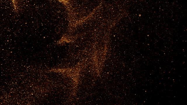 vídeos de stock e filmes b-roll de orange glowing falling particles, slow motion, on black background - cinza