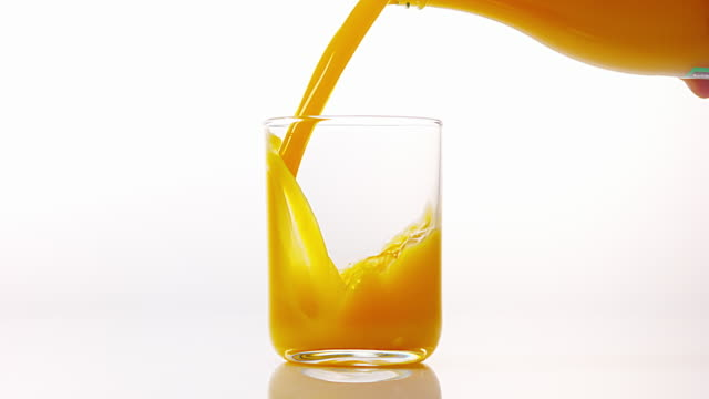 Orange Juice being poured into Glass against White Background, Slow Motion 4K Orange Juice being poured into Glass against White Background, Slow Motion 4K orange juice stock videos & royalty-free footage