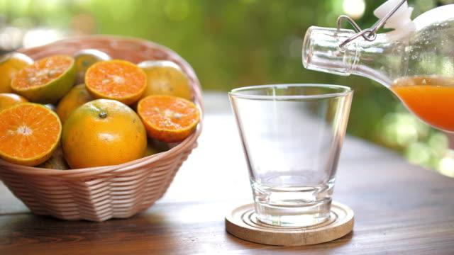 Orange juice fresh fruit with green nature background