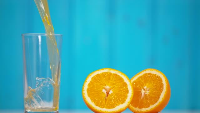 Orange juice pouring in a glass Orange juice pouring  in a glass juicy stock videos & royalty-free footage