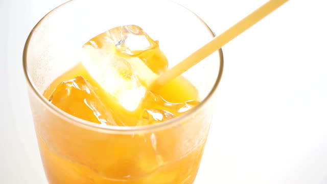 orange juice refreshing Straw water from a glass of water. Top view straw stock videos & royalty-free footage