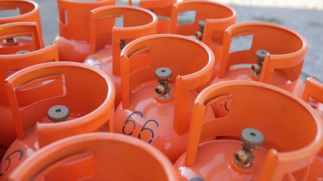 orange lpg tanks - cilindro video stock e b–roll