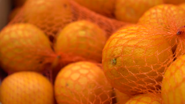 Orange many close up panning on a 4K background in store for buyer your text.